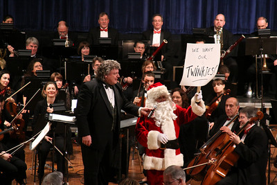 Santa holds up a message from his elves at the Plymouth Phil Holiday Pops Concert.