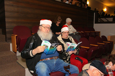 Santa and Mrs. Clause, aka Bill and Sharon Fredericks of Duxbury, peruse the Plymouth Philharmonic Program while waiting for the annual Holiday Pops concert to begin.