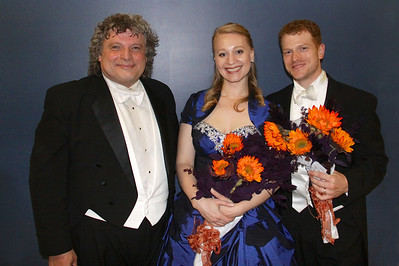 Steven Karidoyanes, with sweat, still on his brow, poses with the two guest performers, Ruth Hart and Andrew Garland, just after exiting the stage at the conclusion of the Phil's and Masterworks Chorale Concert on Saturday, Oct 27th.