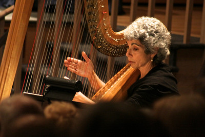 Deborah Feld-Fabisiewicz  plays her harp in the Plymouth Philharmonic Orchestra's performance Saturday night at the Duxbury Performing Arts Center.