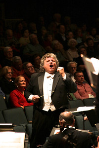 "Steven Karidoyanes shows the intensity and passion of the moment while directing the Pymouth Phil and Masterworks Chorale performance of Vaughn Williams' ""Five Mystical Songs"""
