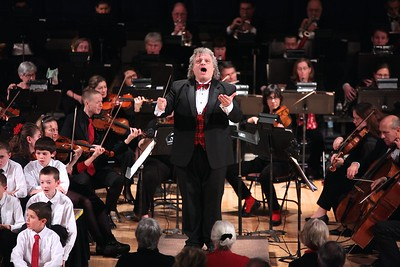 Plymouth Phil director leads the Holiday Pops audience in a carol sing along. Wicked Local Photo/Denise Maccaferri