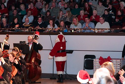Santa shakes hand with audience members on his way his annual chat with Phil Director Steven Karidoyanes. Wicked Local Photo/Denise Maccaferri