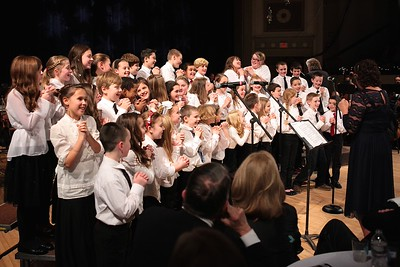 The Federal Furnace Treble Chorus enjoy their performance at the Plymouth Philharmonic Orchestra Holiday Pops concert last weekend. Wicked Local Photo/Denise Maccaferri