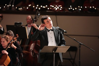 """""""When out on the lawn there arose such a clatter"""". Holiday Pops guest narrator Jordan Rich, from radio station WBZ, reads """"Twas the Night Before Christmas"""" musical interpretation by the Plymouth Philharmonic Orchestra. Wicked Local Photo/Denise Maccaferri"""