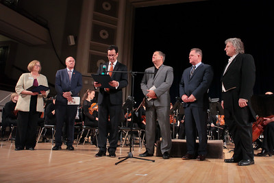 State Senator Vinny deMacedo reads from State Proclamation recognizing the 100th Season of the Plymouth Philharmonic Orchestra. From left, Chair, Phil Board of Directors Elizabeth Pineault, Congressman Bill Keating, State Senator Vinny deMacedo, State Rep Mathew Muratore, State Rep Tom Calter Phil Conductor Steven Karidoyanes. Wicked Local Photo/Denise Maccaferri