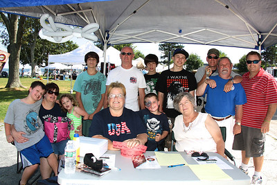 The Harborfest to Benefit MDA Committee and volunteers pose in the wecloming booth during Saturday's annual event at Pilgrim Memoria State Park.