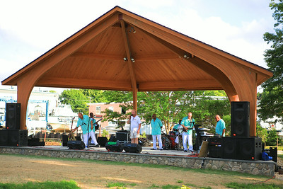 Project Arts Founder, Michael Landers, center, welcomes the Wednesday night crowd to the first concert of the 2014 season and the first using the new stage in Pilgrim State Park.  Preparing to perform is the group Ultimate Soul.