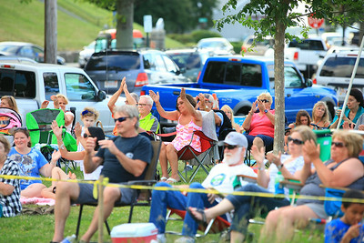 Concert goers clap to the beat of the music by Ultimate Soul at the first Project Arts concert of the season. The concerts are held at the Pilgrim State Park on Water St.every Wednesday night from 6:30-9:30 until August 27