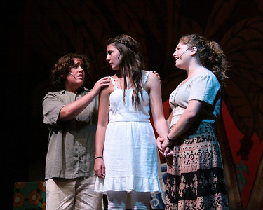 Tonton, (Zander Shooshan), and Mama Eurialie (Olivai Marrow), plead with Ti Muone (Kaleigh Ryan), not to the other side of the island to find her love,Daniel.