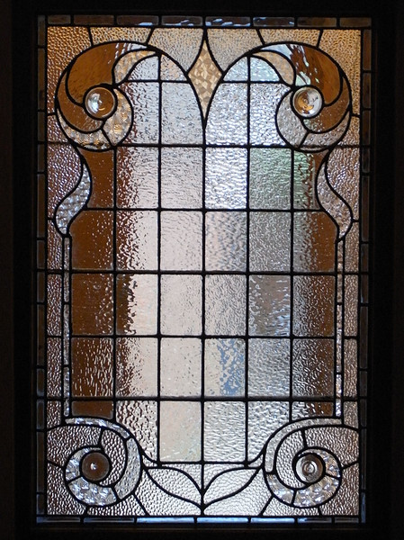 Rebuilt window using various patterned glass with light blue border