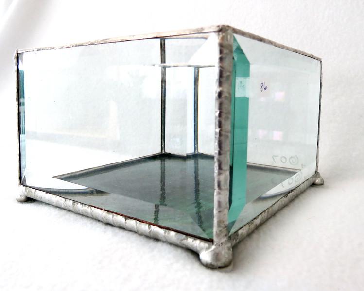 #86. $12.00 Bevel /green glass base candle holder