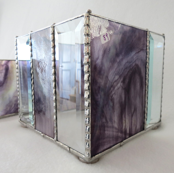 #89. $60.00  Purple marbled glass/bevel candle holder