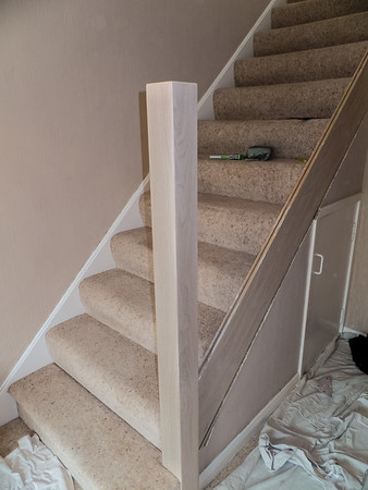 Old newel post extended in height. and veneered.