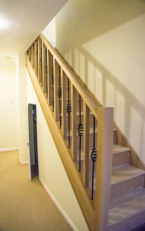New stair inplace with Solid Oak stringers, spindles and newel posts.