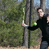 Henry Ramirez of Leominster was using a Spinfire tennis ball machine to hit balls around on the courts at Doyle Field Friday, March 27, 2020.  SENTINEL & ENTERPRISE/JOHN LOVE