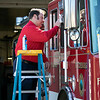 Fitchburg Firefighter/ EMT Sean Roy was cleaning the window's on the truck Friday, March 27, 2020 at the fire station on John Fitch Highway in Fitchburg. SENTINEL & ENTERPRISE/JOHN LOVE