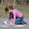 Vivian Tudor , 5, was working on some chalk rainbow in her driveway in Leominster Friday, March 27, 2020 as she took advantage of the good weather. SENTINEL & ENTERPRISE/JOHN LOVE