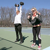 Deb Army, on left, and Patty McDonald where working out at Doyle Field in Leominster Friday, March 27, 2020. Their gym CrossFit EXP in Leominster was having an online workout for their members and Army and McDonald were following along on their phones. SENTINEL & ENTERPRISE/JOHN LOVE