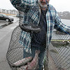 Brian Kelley of Fitchburg shows off the fish he caught at Lake Whalom in Lunenburg on Monday, March 30, 2020. He gets their around 4:30 a.m. to start fishing most days of the week. SENTINEL & ENTERPRISE/JOHN LOVE