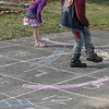 Siblings Charlie Beaudry, 7, and Jayne Beaudry, 4, play Shoots and Ladders in the driveway of their home in Fitchburg Tuesday, March 31, 2020. They had never played before so their mom taught them to play by drawing a very large board for them. SENTINEL & ENTERPRISE/JOHN LOVE