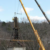 Workers take down a water tower on Route 31 or Princeton Road Tuesday, March 31, 2020. The road was closed down for the work. SENTINEL & ENTERPRISE/JOHN LOVE