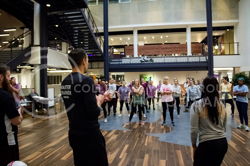 Melissa and Tim Vettel lead a warmup for the Stand Up For Your Sister fundraiser to Kick the stigma of mental illness at the Kansas State Student Union on Nov. 1, 2017. (Alex Shaw | Collegian Media Group)