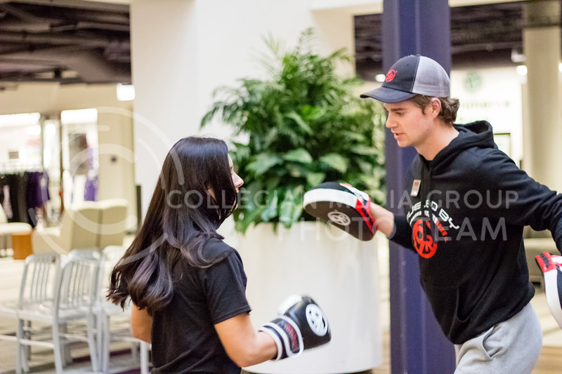 Two kickboxing fitness instructors lead a demonstration at the Stand Up For Your Sister fundraiser to Kick the stigma of mental illness at the Kansas State Student Union on Nov. 1, 2017. (Alex Shaw | Collegian Media Group)