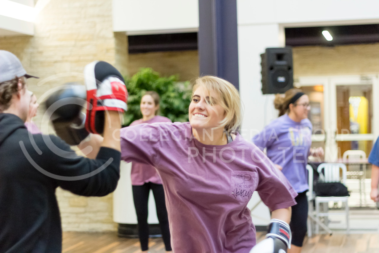 Kansas State Students Participate in a Kickboxing event for the Stand Up For Your Sister fundraiser to Kick the stigma of mental illness at the Kansas State Student Union on Nov. 1, 2017. (Alex Shaw | Collegian Media Group)