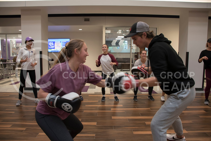 Kansas State Students participate in kickboxing drills for the Stand Up For Your Sister fundraiser event in the Kansas State Student Union in Manhattan, KS, on Nov. 2, 2017. (Olivia Bergmeier | Collegian Media Group)