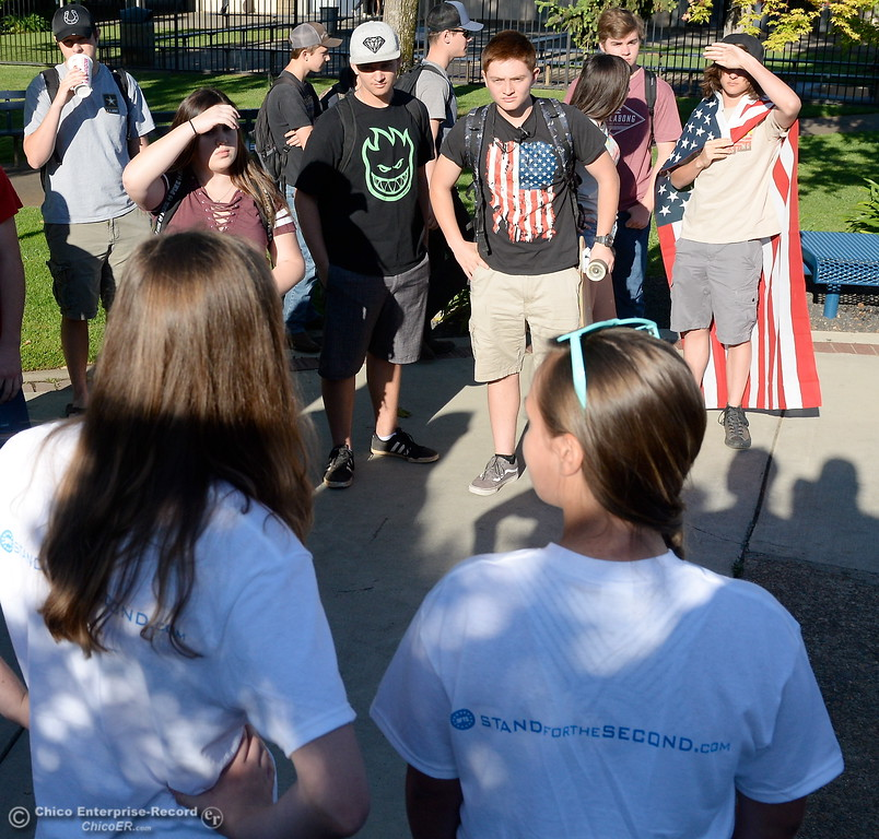 ". A group of students led by sophomores Mackenna Jarvis and Natasha Vose gather to discuss their feelings on their 2nd Amendment rights in front of Pleasant Valley High School in Chico, Calif. during a ""Stand for the 2nd Walkout\"" gathering Wednesday May 2. 2018. (Bill Husa -- Enterprise-Record)"