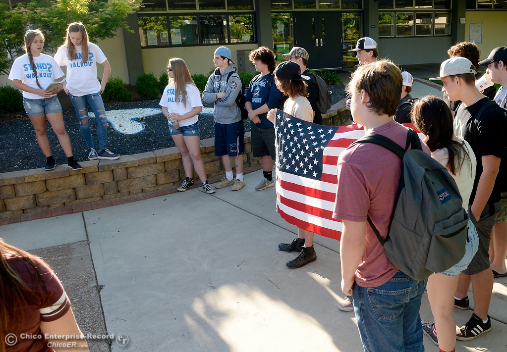 ". A group of students led by sophomores Mackenna Jarvis and Natasha Vose, at left, left to right, gather to discuss their feelings on their 2nd Amendment rights in front of Pleasant Valley High School in Chico, Calif. during a ""Stand for the 2nd Walkout\"" gathering Wednesday May 2. 2018. (Bill Husa -- Enterprise-Record)"