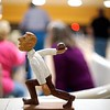 BEN GARVER — THE BERKSHIRE EAGLE<br /> A small wooden statue of a bocce bowler rests on the counter  by the lanes at Imperial Lanes in Pittsfield.