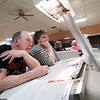 BEN GARVER — THE BERKSHIRE EAGLE<br /> Gordy Fosser and Colleen Hassan keep score on league night at Imperial Lanes in Pittsfield.