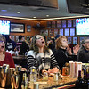GILLIAN JONES — THE BERKSHIRE EAGLE<br /> Patrons of Mazcot's Sports Bar and Grill in Lenox react to the game as they watch the Superbowl on Sunday night.