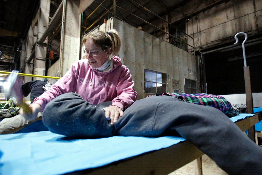 . Third grade teacher Liz Contenta stages bloodied bodies at a Neenah Technical Materials warehouse in Dalton where she and other volunteers from Conte Community School build their \'Haunted Hospital\' float for the annual Halloween Parade in Pittsfield. Wednesday, October 26, 2016. Stephanie Zollshan � The Berkshire Eagle | photos.berkshireeagle.com