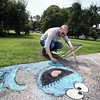 BEN GARVER — THE BERKSHIRE EAGLE<br /> Pat O'Donnell draws a mural at the Norman Rockwell Museum featuring the Cookie Monster from Sesame Street at the Norman Rockwell Museum in Stockbridge, Friday, August 16, 2019. <br /> Sesame Street is featured in the  exhibition Woodstock to the Moon: 1969 Illustrated.