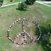BEN GARVER — THE BERKSHIRE EAGLE<br /> In celebration of the 50th anniversary of Woodstock, visitors and staff at the Norman Rockwell Museum made a human peace sign in conjunction with the exhibition Woodstock to the Moon: 1969 Illustrated. Friday, August 16, 2019.