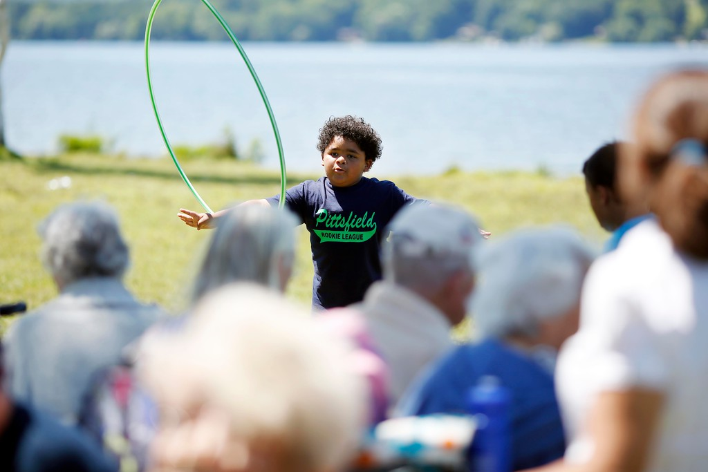 . Members of the Froio Senior Center\'s Supportive Day Program for \'Golden Seniors\' watch kids from the Marilyn Hamilton Literacy Sports Program hula hoop as they celebrate their Integration Literacy Program at Onota Lake in Pittsfield. Thursday, August 4, 2016. Stephanie Zollshan � The Berkshire Eagle | photos.berkshireeagle.com
