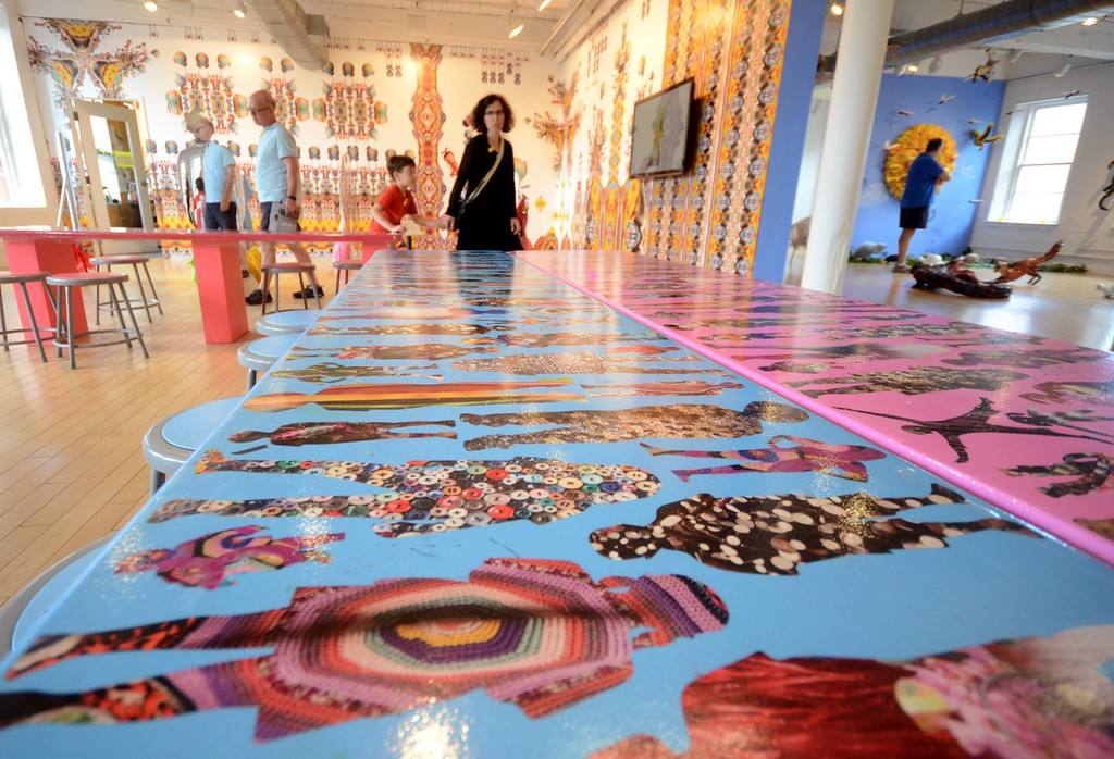 . Tables and walls in the Kidspace artbar are covered with highly patterned wallpaper designed by artist Nick Cave in collaboration with Bob Faust as part of \'Kaleidescope Playground,\' which is presently on display at Kidspace at Mass MoCA. Wednesday August 3, 2016. Gillian Jones � The Berkshire Eagle | photos.berkshireeagle.com