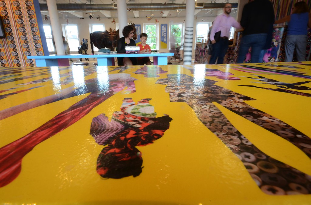 . Tables in the Kidspace artbar are covered with highly patterned wallpaper designed by artist Nick Cave in collaboration with Bob Faust as part of \'Kaleidescope Playground,\' which is presently on display at Kidspace at Mass MoCA. Wednesday August 3, 2016. Gillian Jones � The Berkshire Eagle | photos.berkshireeagle.com