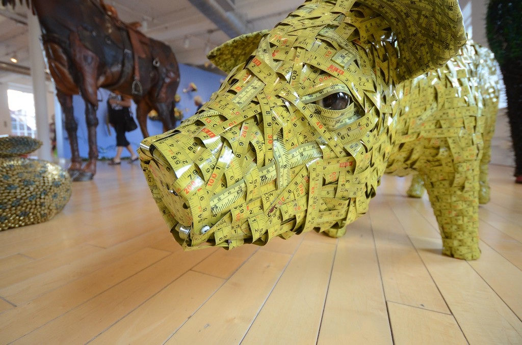. In \'Here Comes the Sun,\' Federico Uribe\'s menagerie of sculptured animals includes a pig made of woven, tape measures. Wednesday August 3, 2016. Gillian Jones � The Berkshire Eagle | photos.berkshireeagle.com