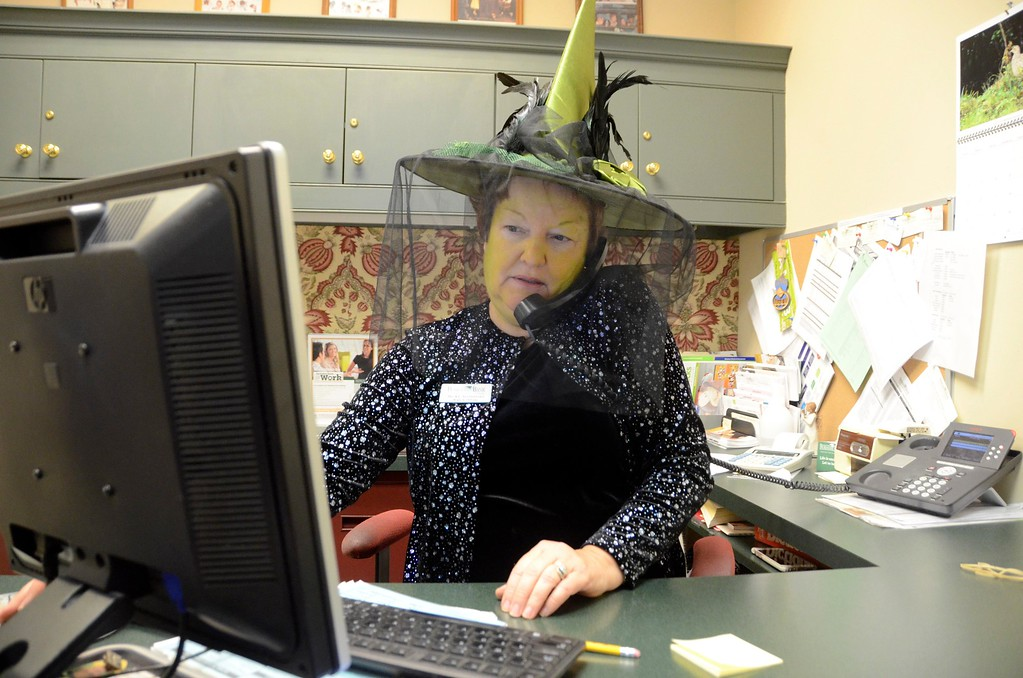 . Berkshire Bank Branch Manager Becky Sorrentino is dressed as Selena, the witch, at the Lenox Branch where employees dressed as characters from the t.v. show \'Once\' for Halloween this year. Every year Berkshire Bank employees are encouraged to dress up for Halloween. Monday, October 31, 2016. Gillian Jones � The Berkshire Eagle | photos.berkshireeagle.com