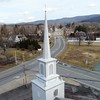 BEN GARVER — THE BERKSHIRE EAGLE<br /> New Lebanon is a crossroads between the Berkshires and New York. New Lebanon Congregational Church in the foreground at the intersection of Routes 20 and 22