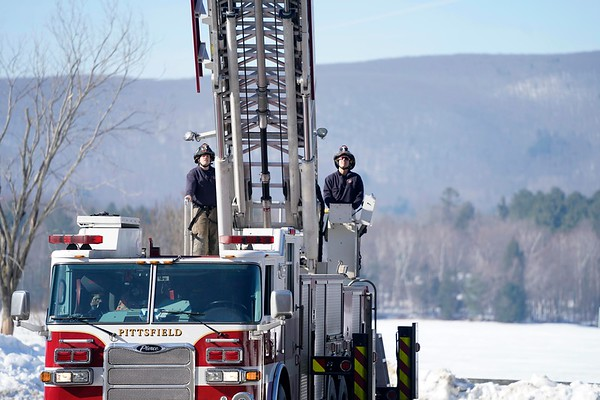 BEN GARVER — THE BERKSHIRE EAGLE<br /> Pittsfield firefighters John Couper and Steve Papa test the ladder on truck 2 at Burbank Park before their shift, Monday, February 4, 2019. <br /> Truck 2 is kept at the central fire station and testing it before every shift in normal procedure.