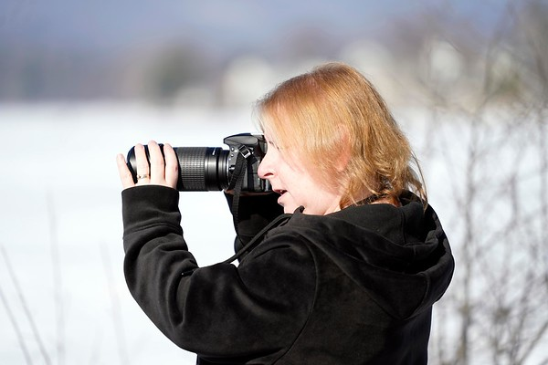 BEN GARVER — THE BERKSHIRE EAGLE<br /> Birdwatcher and photographer Kathy Herforth scans Onota Lake in Pittsfield in the warm weather, monday February 4, 2019.