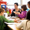 BEN GARVER — THE BERKSHIRE EAGLE<br /> Alison McGee helps students with their writing skills in preparation for MCAS in Donna Bell's third grade class at Stearns School.