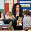 BEN GARVER — THE BERKSHIRE EAGLE<br /> Christine Alberti works with third graders at Stearns School on reading comprehension in Donna Bell's third grade class in preparation on MCAS.