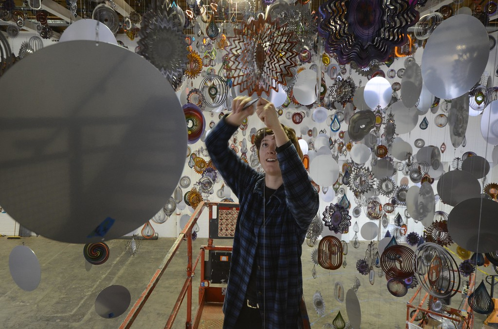 . Athena Knisley works on the installation of Nick Cave\'s \'Until\' in Mass MoCA\'s football size gallery. The show opens on October 15. Monday, October 3, 2016. Gillian Jones � The Berkshire Eagle | photos.berkshireeagle.com