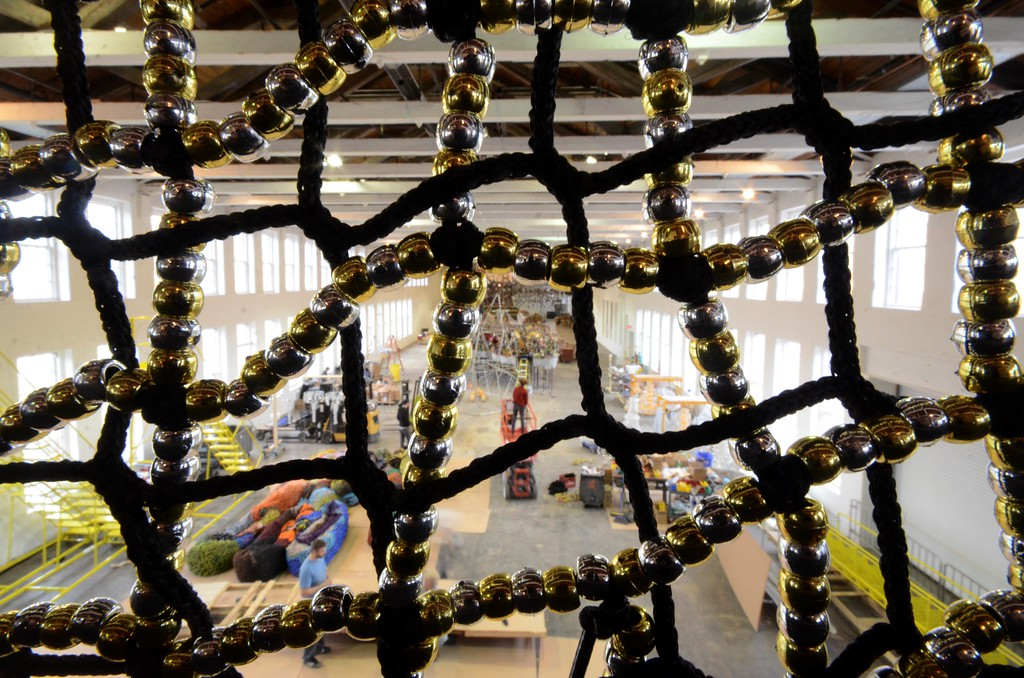 . A view through a beaded curtain into Mass MoCA\'s Building 5 where Nick Cave\'s \'Until\' is under construction. The show opens on October 15. Tuesday, October 4, 2016. Gillian Jones � The Berkshire Eagle | photos.berkshireeagle.com